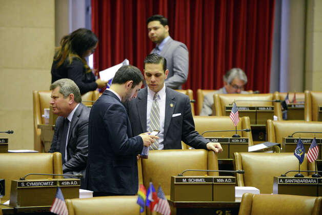 Assemblyman Angelo Santabarbara (D-Rotterdam), center, confers with a colleague in the Assembly Chamber before the start of session Monday afternoon, March 30, 2015, at the Capitol in Albany, N.Y. (Will Waldron/Times Union) Photo: WW, Albany Times Union / 00031230A