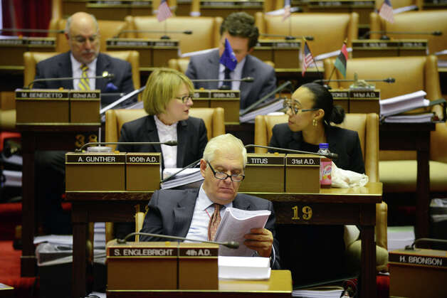 Assemblyman Steve Englebright (D-Setauket) reads over bills from his seat in the Assembly Chamber before the start of session Monday afternoon, March 30, 2015, at the Capitol in Albany, N.Y. (Will Waldron/Times Union) Photo: WW, Albany Times Union / 00031230A