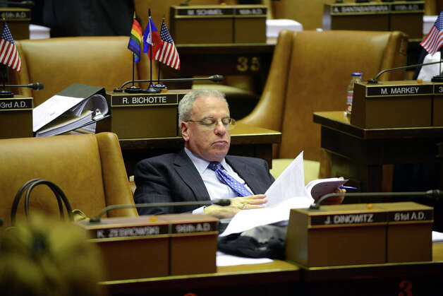 Assemblyman Jeffrey Dinowitz (D-Bronx) reads over bills from his seat in the Assembly Chamber before the start of session Monday afternoon, March 30, 2015, at the Capitol in Albany, N.Y. (Will Waldron/Times Union) Photo: WW, Albany Times Union / 00031230A
