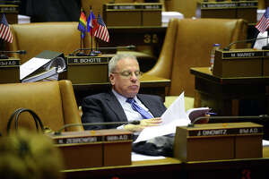 Assemblyman Jeffrey Dinowitz (D-Bronx) reads over bills from his seat in the Assembly Chamber before the start of session Monday afternoon, March 30, 2015, at the Capitol in Albany, N.Y. (Will Waldron/Times Union)