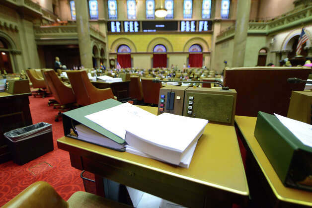 Bills sit on the desks of lawmakers in the Assembly Chamber before the start of session Monday afternoon, March 30, 2015, at the Capitol in Albany, N.Y. (Will Waldron/Times Union) Photo: WW, Albany Times Union / 00031230A