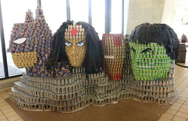 "Sculptures made from cans and other nonperishable foods are displayed at the State Museum during the fifth annual CANstruction ""Heroes"" Program to benefit the Food Pantries for the Capital District Wednesday, April 1, 2015, in Albany, N.Y. (Will Waldron/Times Union) Photo: WW / 00031261A"