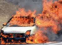 A car fire just north of the Twin Bridges slows northbound traffic Wednesday afternoon April 1, 2015 in Clifton Park, NY.  (John Carl D'Annibale / Times Union)