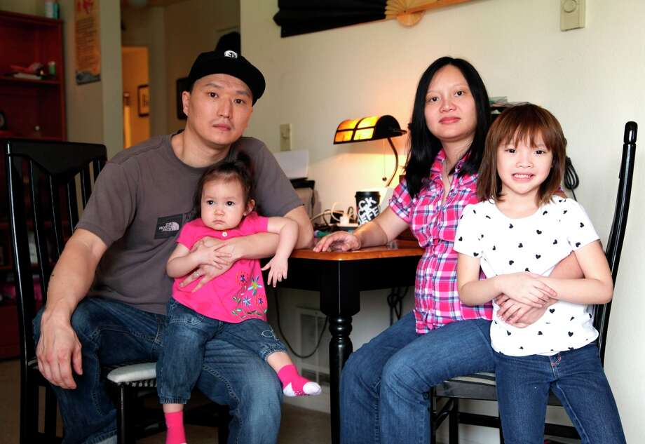 Adam Crapser sits with his wife and daughters in their Vancouver, Wash., home. Crapser's adoptive parents never sought U.S. citizenship for him. Photo: Gosia Wozniacka / Associated Press / AP