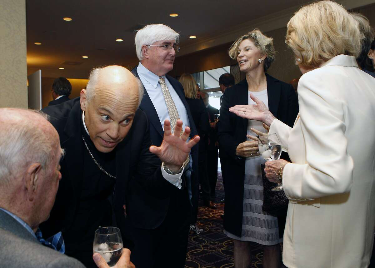 Archdiocese of San Francisco Salvatore Cordileone speaks with former U.S. Secretary of State George Shultz during the S.F. Chronicle's Visionary of the Year event at the Fairmont Hotel, Tuesday, March 31, 2015, in San Francisco, Calif.