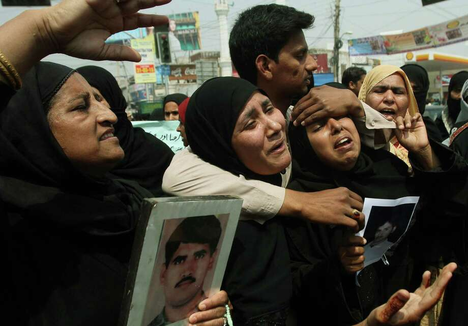 Family members of stranded Pakistanis in Yemen protest to demand their return, as they gather in Multan, Pakistan, Wednesday, April 1, 2015. Pakistan evacuated some 500 of its citizens by a special plane from the Yemeni city of Hodeida. Pakistan said some 3,000 of its citizens live in Yemen. Photo: Asim Tanveer / Associated Press / AP