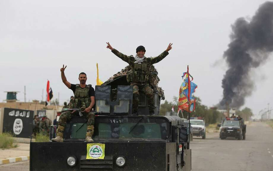 "Iraqi forces celebrate a ""magnificent victory"" after driving Islamic State militants out of Tikrit. Photo: AHMAD AL-RUBAYE / AFP / Getty Images / AFP"