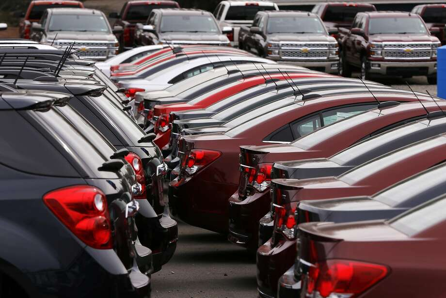 In this Monday, March 23, 2015 photo, Chevrolet vehicles are on display at a dealership in Gibsonia, Pa. Automakers release vehicle sales for March on Wednesday, April 1, 2015. (AP Photo/Gene J. Puskar) Photo: Gene J. Puskar, Associated Press