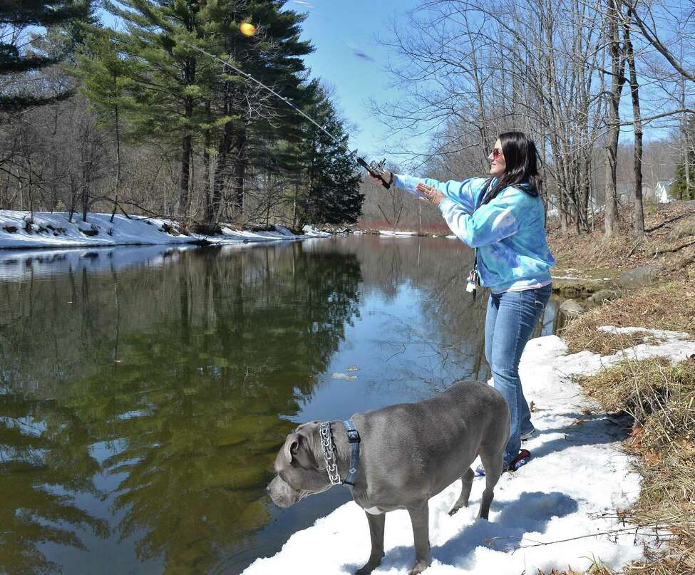 Rachael Britton of Bethlehem and her dog Ralphy fished the Kayaderosseras Creek on opening day of trout fishing season on April 1, 2015 in Milton, NY. (John Carl D'Annibale / Times Union)
