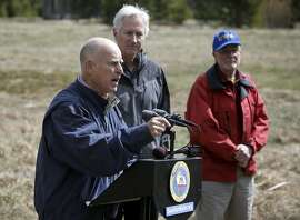 California Governor Edmund G. Brown Jr. talks about actions he is taking to save water in the State during this fourth year of drought, Frank Gehrke  Chief of the California Cooperative Snow Surveys Program, (right) and Mark Cowin director of the department of water resources, (center) join the Governor during what would have been the fourth and final snow survey of the season if there was any snow, at Phillips Station, Calif., as seen on Wed. April 1, 2015.