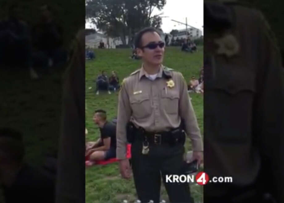 Rec and Park ranger J. Chan was verbally assailed when he accosted partiers playing amplified music Dolores Park. Photo: Kron4