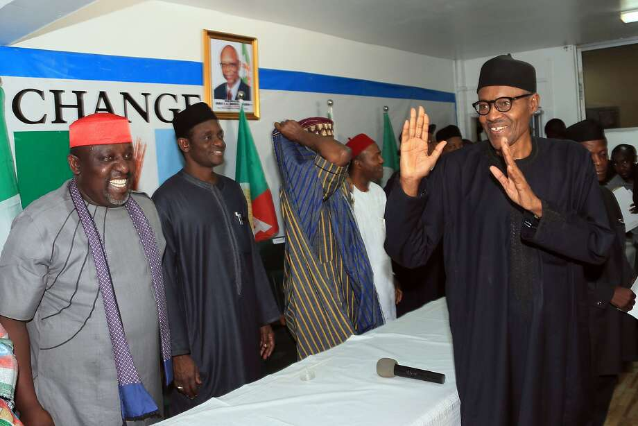 """Nigerian president-elect Muhammadu Buhari (R) gestures in Abuja on April 1, 2015. Nigeria's new president-elect Muhammadu Buhari hailed polls that will lead to the first democratic change of power in Africa's most populous nation as """"historic"""" hours after he secured a decisive victory. AFP PHOTO / STRINGER-/AFP/Getty Images Photo: -, AFP / Getty Images"""