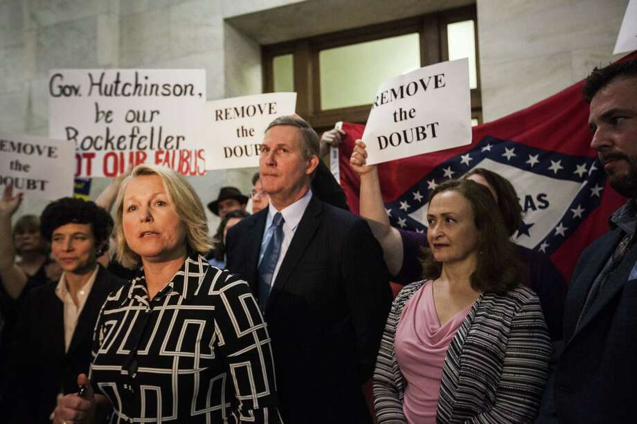 Tippi McCullough, an LGBT activist and teacher, addresses the media after Gov. Asa Hutchinson's news conference at the state Capitol in Little Rock, Ark. Photo: Andrea Morales / 2015 Getty Images