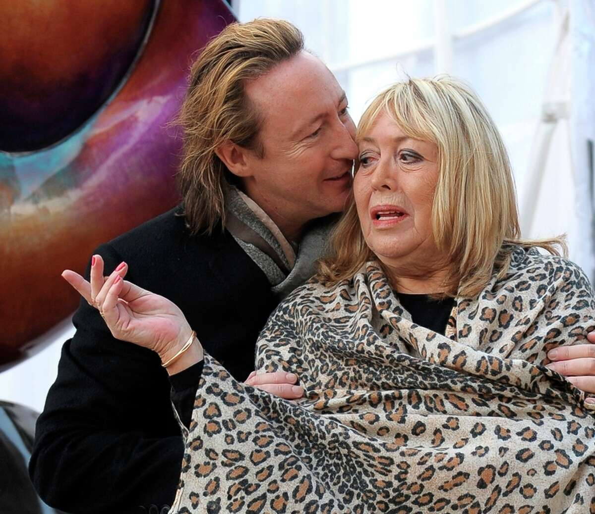 Cynthia Lennon and son, Julian, attend the 2010 unveiling of a Liverpool monument to John Lennon.