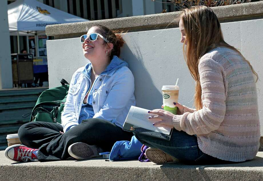 Junior students Kathleen Barakat, 21, left, and Emma Folchetti, 20, enjoy the warm sun in between classes at the University at Albany on Wednesday, April 1, 2015 in Albany, N.Y. The two girls are high school friends from Westchester. (Lori Van Buren / Times Union) Photo: Lori Van Buren