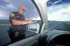 County sheriff giving speeding ticket, New Mexico
