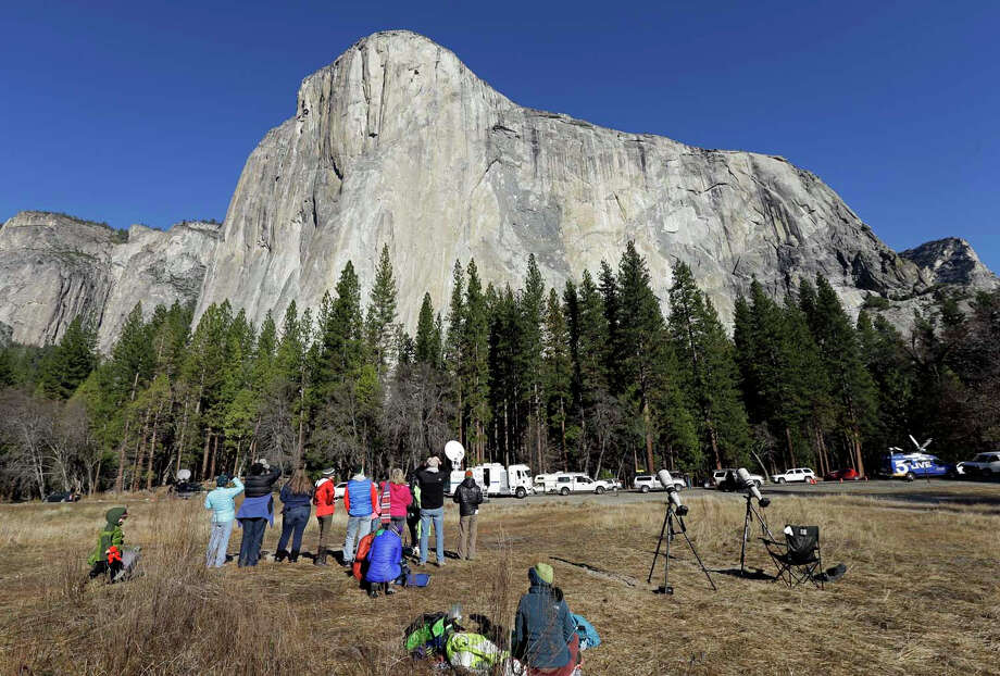 Spectators watch the free climb of El Capitan at Yosemite park, which recently raised its fees. Photo: Ben Margot / Associated Press / AP