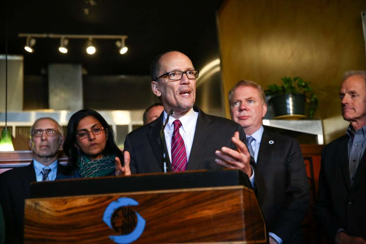 """U.S. Labor Secretary Tom Perez praises Seattle for boosting pay: """"You are setting the trend for America."""" He wants to chair the Democratic Party as it recovers from November's crushing loss."""