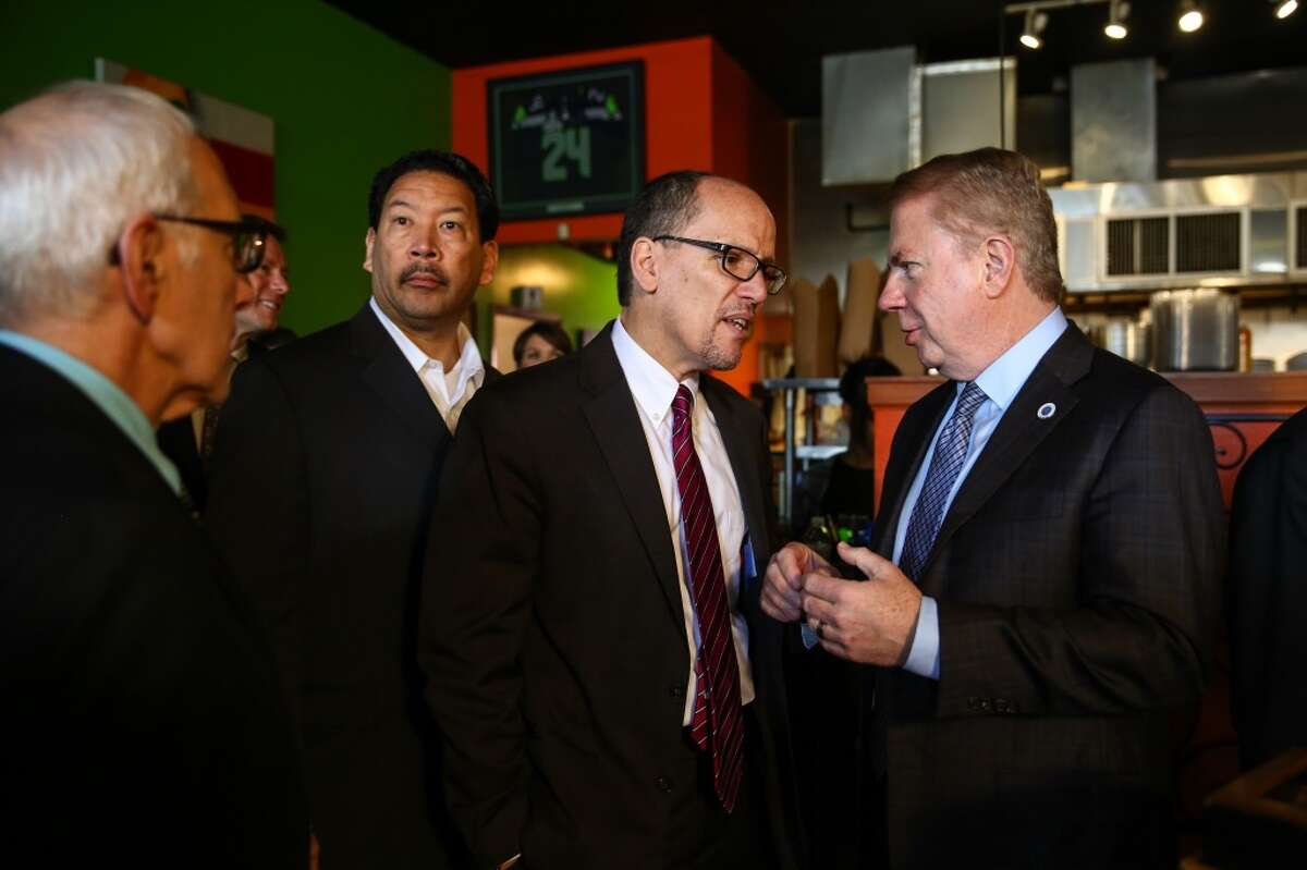 Seattle Mayor Ed Murray confers with U.S. Labor Secretary Tom Perez. Seattle has enacted a phased in $15-an-hour minimum wage. The Obama administration has been unable to get Congress to enact a $10-an-hour federal minimum wage.