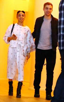 (L-R) Singer FKA Twigs and Robert Pattinson attend a Surface Magazine Event With Hans Ulrich Obrist And FKA Twigs at Edition Hotel on December 4, 2014 in Miami, Florida.