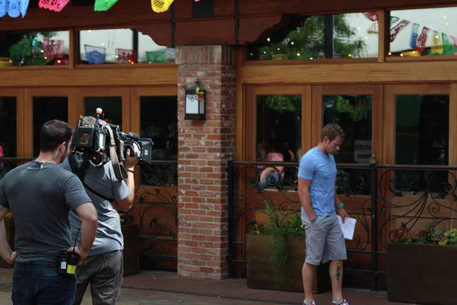 "A camera crew captures footage for the upcoming season of ABC's ""The Bachelorette."" Photo: Photo By Tyler White/SAEN"