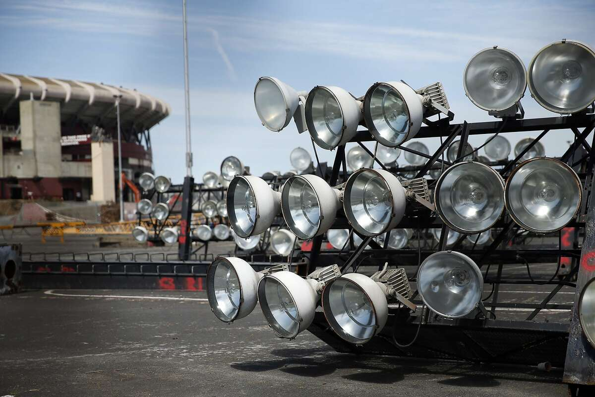 Stadium lights in the parking lot as the demolition of Candlestick Park continues in San Francisco, Calif., on Wednesday, April 1, 2015.