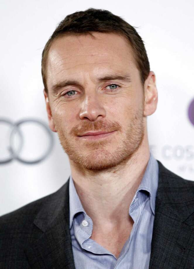 "FILE - In this Nov. 9, 2011 file photo, cast member Michael Fassbender arrives at a screening of ""Shame"" during AFI FEST 2011, in Los Angeles. Fassbender was nominated Thursday, Dec. 15, 2011 for a Golden Globe award for best actor in a drama for his role in the film. (AP Photo/Matt Sayles, file) Photo: Matt Sayles / AP2011"