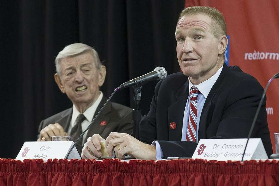 Retired NBA basketball All-Star and St. John's alumnus Chris Mullin, right, speaks alongside his former coach Lou Carnesecca, during an NCAA college basketball news conference introducing Mullin as the new men's basketball coach at St. John's, Wednesday, April 1, 2015, in New York.  (AP Photo/John Minchillo) Photo: John Minchillo, Associated Press