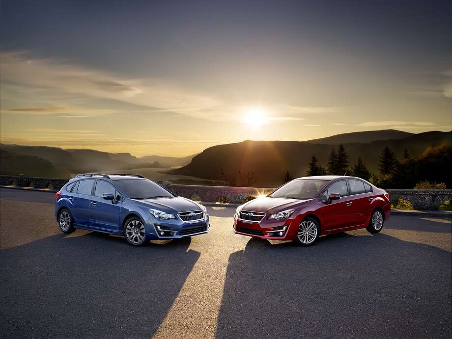 The 2015 Impreza debuts revised front styling with a new front bumper, grille and headlights that give it a closer kinship to the all-new 2015 Legacy. / 2969