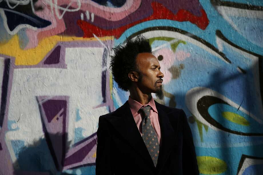 Known for his raw blues music, Xavier Dphrepaulezz, who performs under the name Fantastic Negrito, visits his old haunts in downtown Oakland on Monday March 30, 2015. He recently won NPR Music's Tiny Desk Concert competition out of 7,000 entries. Photo: Mike Kepka, The Chronicle