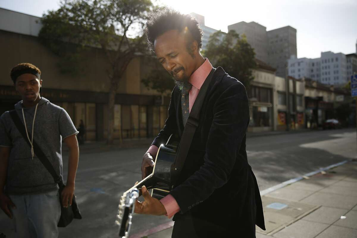 Known for his raw blues music, Xavier Dphrepaulezz, who performs under the name Fantastic Negrito, visits his old haunts in downtown Oakland on Monday March 30, 2015. He recently won NPR Music's Tiny Desk Concert competition out of 7,000 entries.