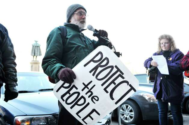 Pete Looker of Glenville addresses taking part in a protest against the shipping of oil in tank rail cars outside of Albany City Hall on Wednesday, April 1, 2015, in Albany, N.Y. (Paul Buckowski / Times Union)