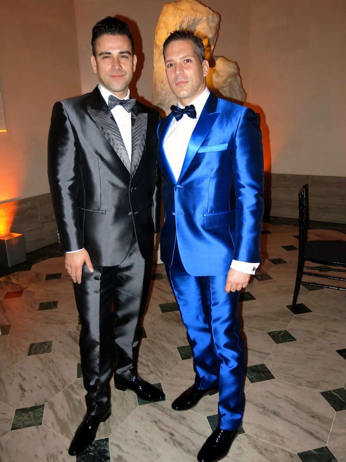 Designer Rubin Singer (at left) designed a number of gala gowns as well as this blue tux (ar right) worn by Carlos Melia, a a travel blogger, LGBT activist and winner of Mr. Gay Argentina 2008.