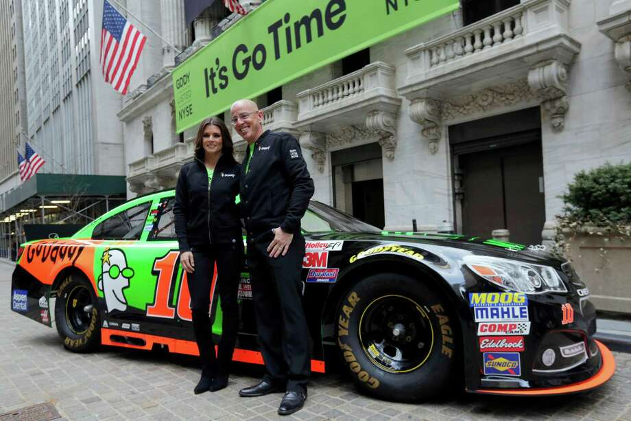 Racer Danica Patrick and GoDaddy CEO Blake Irving visit the New York Stock Exchange.  Photo: Richard Drew, STF / AP