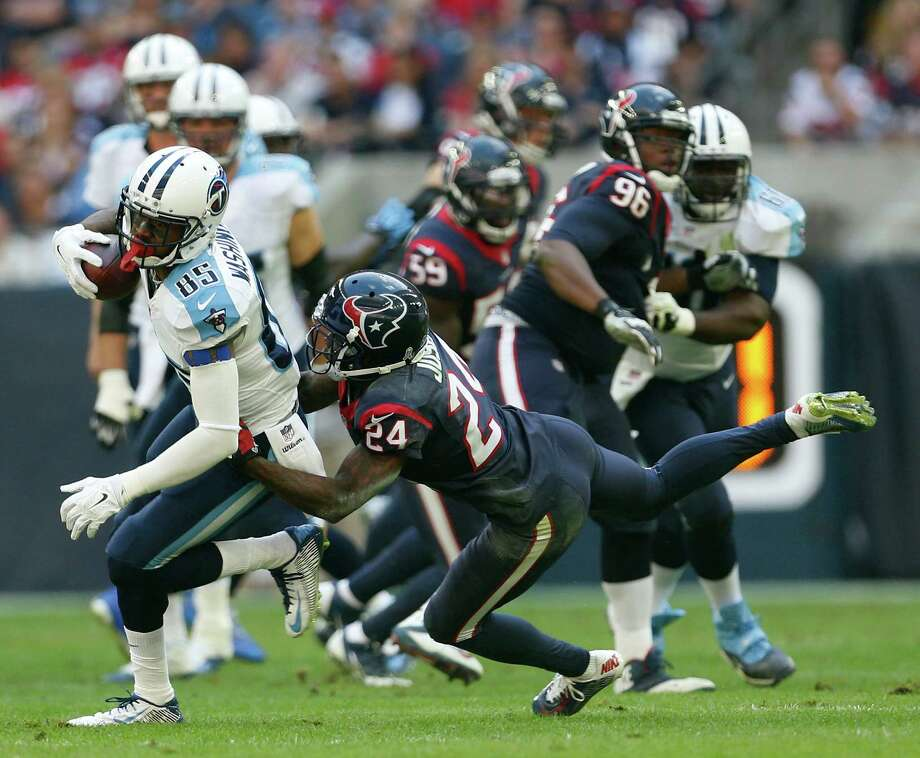 Nate Washington will be catching passes for the Texans rather than against them, as he has done for the past six seasons with the Titans. Photo: Karen Warren, Staff / © 2014 Houston Chronicle