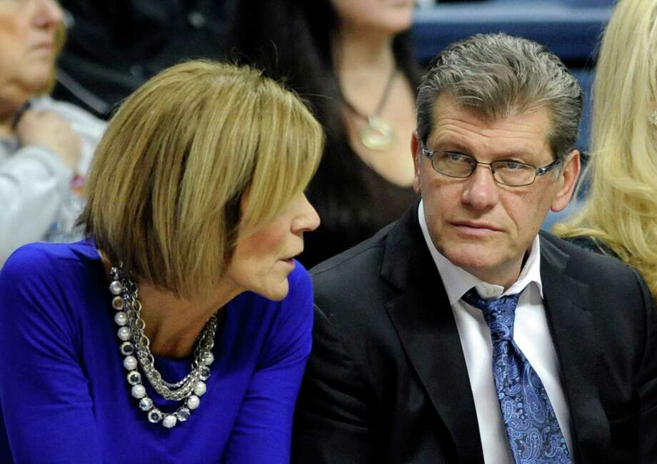 Connecticut head coach Geno Auriemma, right, listens to associate head coach Chris Dailey, during the first half of an NCAA college basketball game against Memphis in Storrs, Conn., on Saturday, Feb. 28, 2015. (AP Photo/Fred Beckham) Photo: Fred Beckham, FRE / FR153656 AP