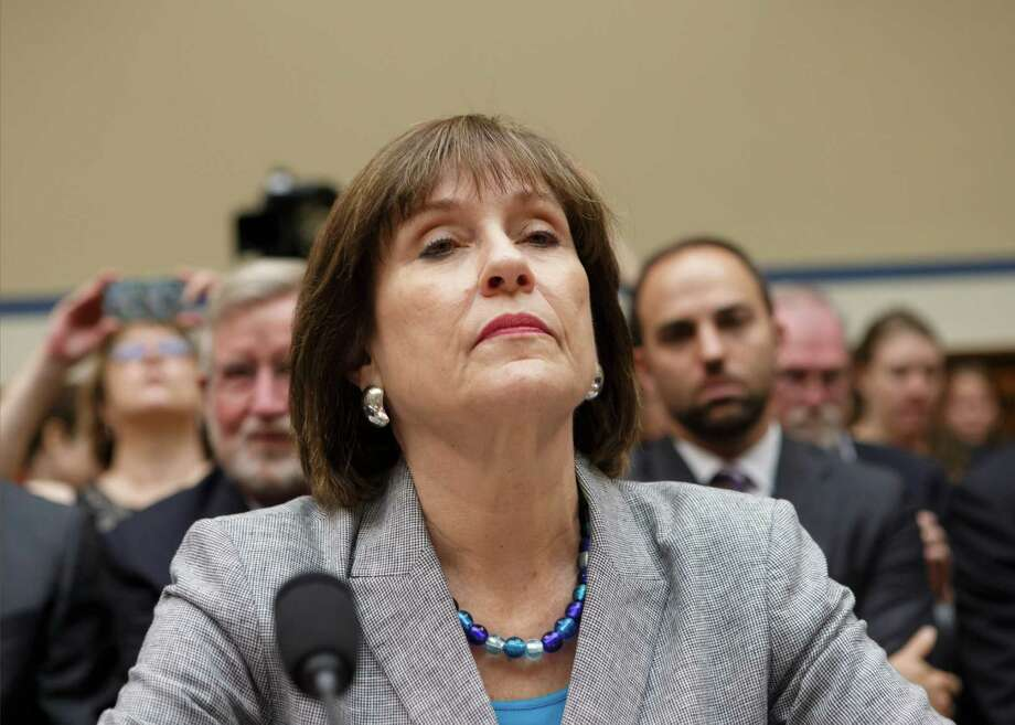 FILE - In this May 22, 2013 file photo, Internal Revenue Service official Lois Lerner listens during a House Oversight Committee hearing on Capitol Hill in Washington. The Justice Department won't seek criminal contempt charges against Lerner, the former IRS official at the center of a controversy over how the agency treated conservative political groups. (AP Photo/J. Scott Applewhite, File) Photo: J. Scott Applewhite, STF / AP