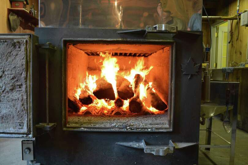 A fire burns constantly to boil down sap to make syrup at Wild Hill Maple in Salem on March 21 durin