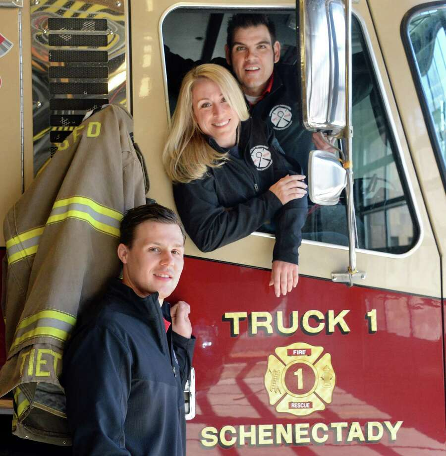 "Event directors, from left, firefighters Brendon Davis, Amiee Parlatore and Capt. Chris Keough at the firehouse Wednesday April 1, 2015 in Schenectady, NY. The Schenectady Firefighter's Cancer Foundation will present the ""Laughter Saves Lives Comedy Tour"" on Saturday at Proctor's Theatre. Proceeds will benefit both the Schenectady Firefighter's Cancer Foundation and Laughter Saves Lives Foundation to support local firefighters and the fight against cancer.  (John Carl D'Annibale / Times Union) Photo: John Carl D'Annibale / 00031211A"