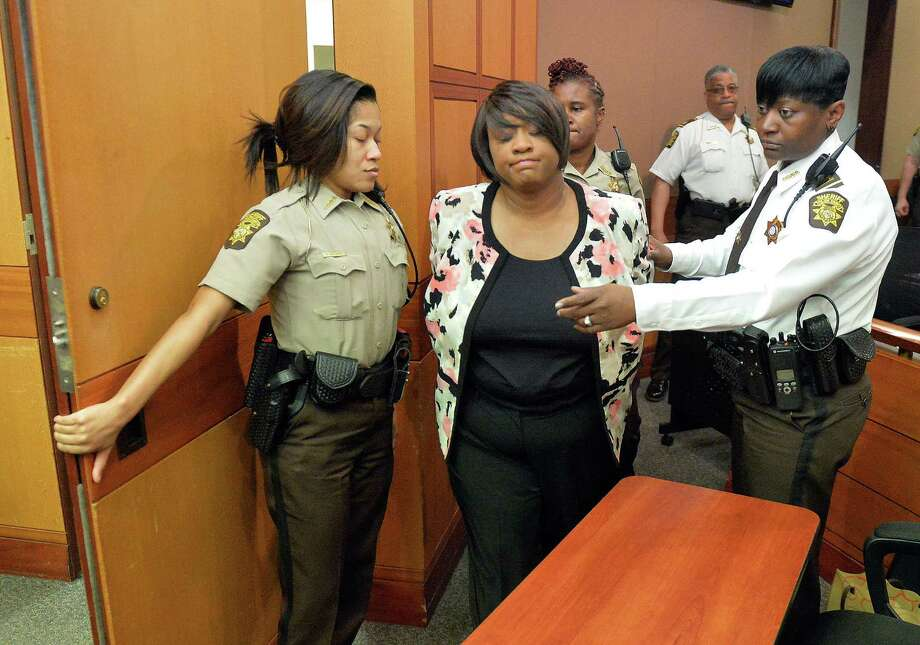 Former school team director Tamara Cotman is taken into custody after a jury found her guilty in the Atlanta public schools cheating trial on Wednesday.  Photo: Kent D. Johnson, POOL / Pool Atlanta Journal-Constitutio