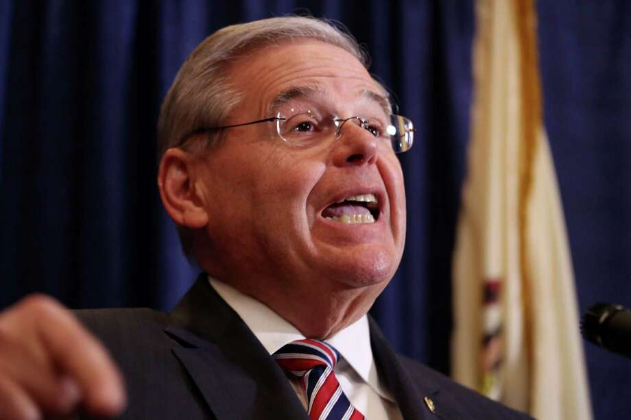 U.S. Sen. Bob Menendez speaks during a news conference, Wednesday, April 1, 2015, in Newark, N.J. Menendez, the top Democrat on the U.S. Senate Foreign Relations Committee, was indicted on corruption charges, accused of using his office to improperly benefit an eye doctor and political donor. (AP Photo/Craig Ruttle) Photo: Craig Ruttle, FRE / FR61802 AP