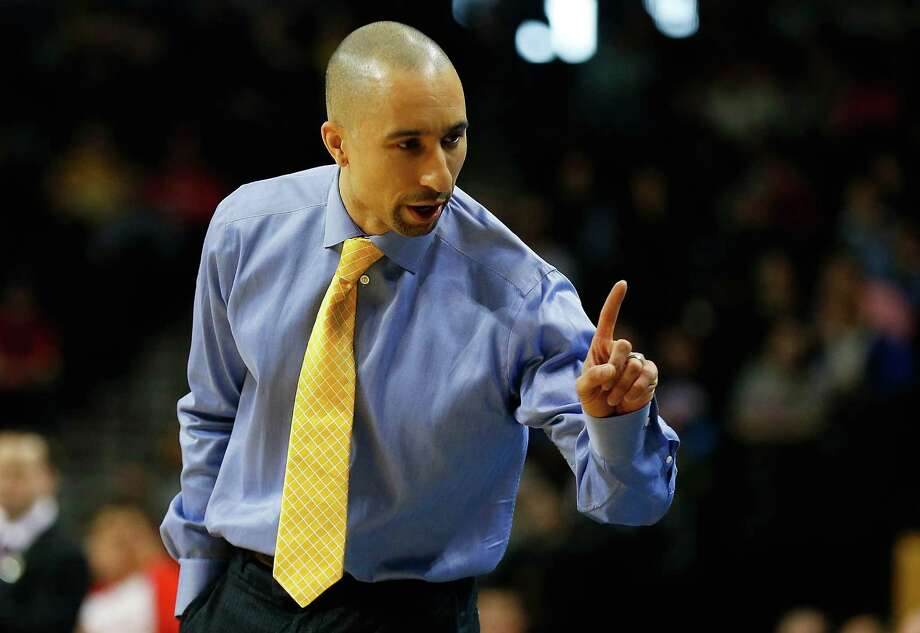 NEW YORK, NY - MARCH 15:  head coach Shaka Smart of the Virginia Commonwealth Rams calls out from the bench against the Dayton Flyers during the Atlantic 10 Basketball Tournament - Championship game at Barclays Center on March 15, 2015 in New York, New York.  (Photo by Mike Stobe/Getty Images) Photo: Mike Stobe, Stringer / Getty Images / 2015 Getty Images