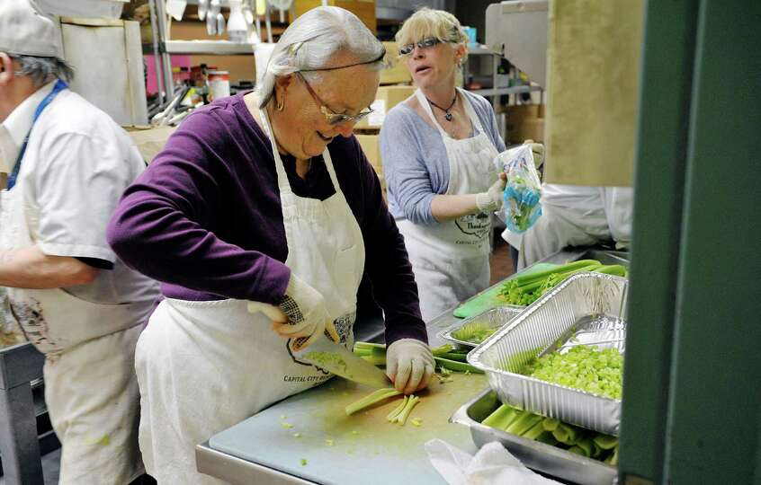 Volunteers, Sue Hurd, left, of East Greenbush and Marie Parker of Cairo cut up celery Wednesday, Apr
