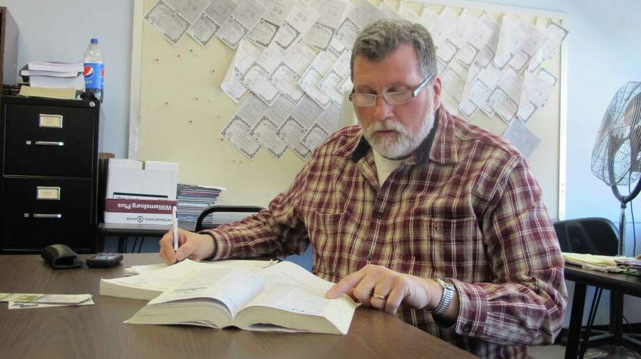 Larry Gorski, 58, of Cheektowaga, prepares to take the TASC test toward his high school equivalency diploma during an adult education class at the Maryvale Community Education Building in Cheektowaga, N.Y. on March 23, 2015.  The GED was overhauled last year to reflect the Common Core standards that have been adopted by most states and emphasize critical thinking. Two new high school equivalency exams that also incorporate some of those standards were also introduced last year.  (AP Photo/Carolyn Thompson) ORG XMIT: RPCT201 Photo: Carolyn Thompson / AP