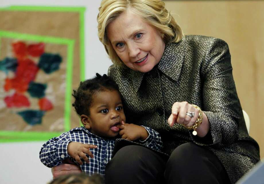 Hillary Rodham Clinton talks to a youngster during a visit to an early childhood development center in the Brooklyn borough of New York, Wednesday, April 1, 2015. Clinton and New York City first lady Chirlane McCray joined forces with the city's deputy mayor in announcing a program to get parents to talk to their young children to enhance their development. (AP Photo/Kathy Willens, Pool}) ORG XMIT: NYKW101 Photo: Kathy Willens / Pool AP