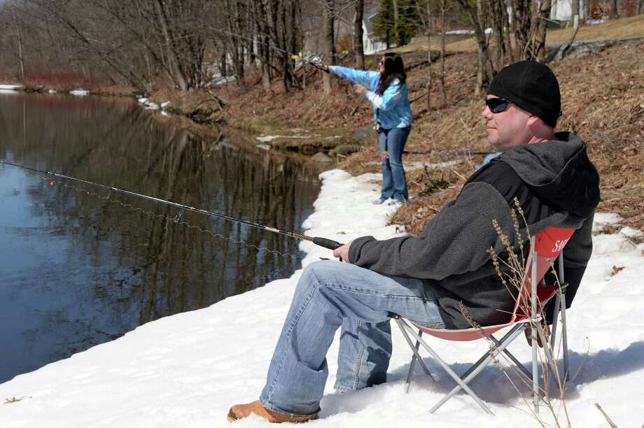 Christopher Rose, right, of Saratoga Springs and Rachael Britton of Bethlehem spend a sunny day on the banks of Kayaderosseras Creek on opening day of trout fishing season Wednesday April 1, 2015 in Milton, NY.  (John Carl D'Annibale / Times Union) Photo: John Carl D'Annibale / 00031234A