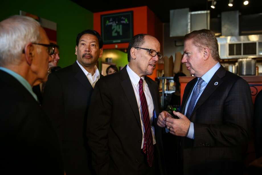 U.S. Labor Secretary Tom Perez, center, speaks with Seattle Mayor Ed Murray during an event implementing the first increase toward Seattle's new $15 per hour minimum wage on Wednesday, April 1, 2015 at Island Soul Restaurant in Columbia City. (Joshua Trujillo, seattlepi.com) Photo: JOSHUA TRUJILLO, SEATTLEPI.COM