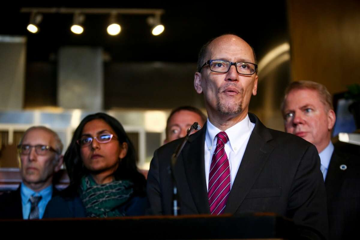 Unable to persuade Congress to hike the $7.25 an hour federal minimum wage, U.S. Labor Secretary Tom Perez came to Seattle to celebrate the Emerald City's new $15 per hour minimum wage on Wednesday, April 1, 2015 at Island Soul Restaurant in Columbia City. (Joshua Trujillo, seattlepi.com)