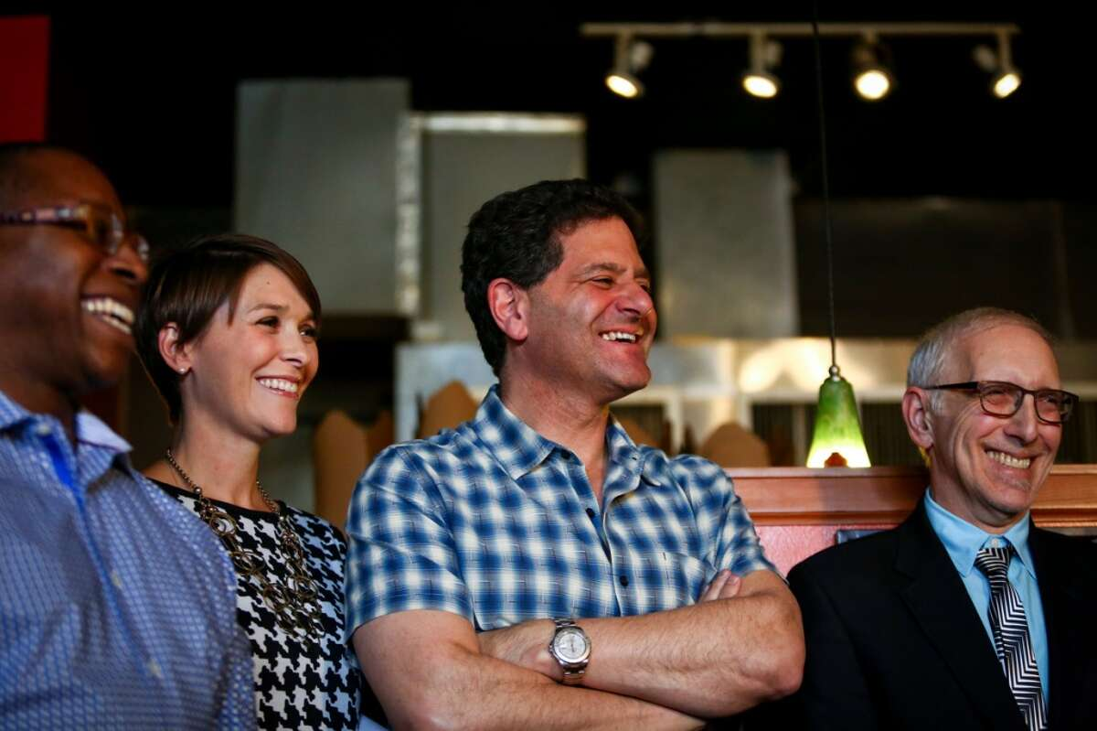 Nick Hanauer, center:  Seattle entrepreneur backs new state overtime rule that would boost minimum way for salaried workers. Several business groups are saying it is too fast and too costly (Joshua Trujillo, seattlepi.com)