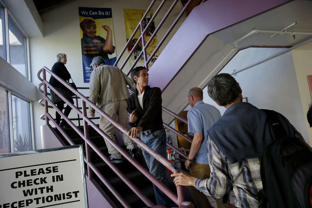 Clients planning to attend a meeting of the AASCEND climb the stairs at The Arc building on Howard Street. A meeting of the AASCEND, which is a group in the autism spectrum, met at the The Arc in San Francisco, Calif. Wednesday April 1, 2015.